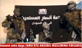 "An image reportedly showing members of Ansaru in November. Photograph: AFP/Getty Images Image source: Guardian, ""Ansaru, the Islamist Group behind Foreign Hostage Killings"""