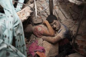 """Last Embrace"": Heartbreaking Bangladesh Factory Photo Couple in Final Embrace, Huffington Post Source: Bangladeshi photographer Taslima Akhter"
