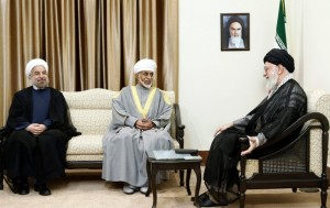 "Left to Right: President Rouhani, Sultan of Oman, (Iran's first Supreme Leader Ayatollah Khomeini's picture on the wall), Ayatollah Khamenei. Image Source: ""Iran's Supreme Leader, Ayatollah Ali Khamenei, Endorses Diplomacy over Militarism,"" Washington Post"