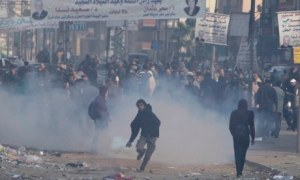 "Image Source: ""Egyptian Protesters Killed as State Crackdown Widens – protesters shot dead as Muslim Brotherhood activists battle against police, say medical and security sources,"" The Guardian, 3 January 2014."