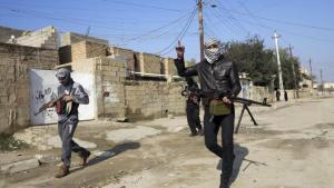 "Falluja – Gunmen fighters walk with their weapons in the streets of Ramadi, 60 miles west of Baghdad.  Image Source: ""Time to End al Qaeda Presence in Falluja: Iraq's Maliki,"" Reuters"